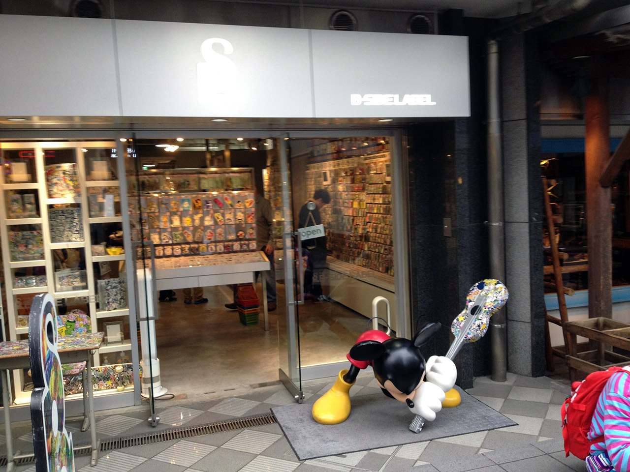 sticker store in japan with mickey mouse smashing guitar