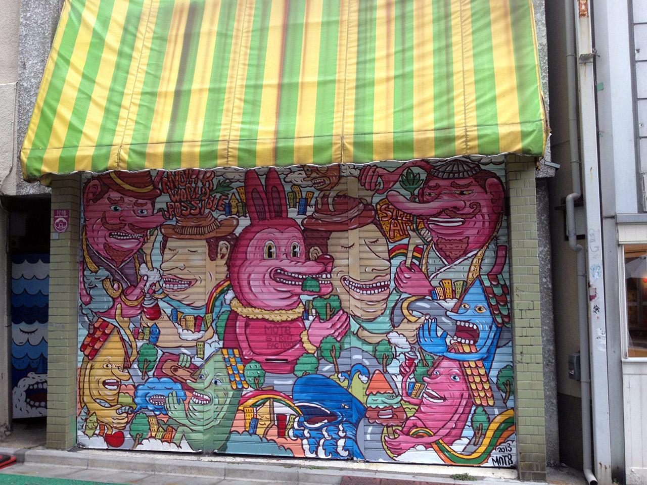 door covered in graffiti pink coyote japan
