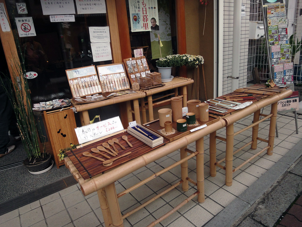 bamboo utensils displayed in front of shop