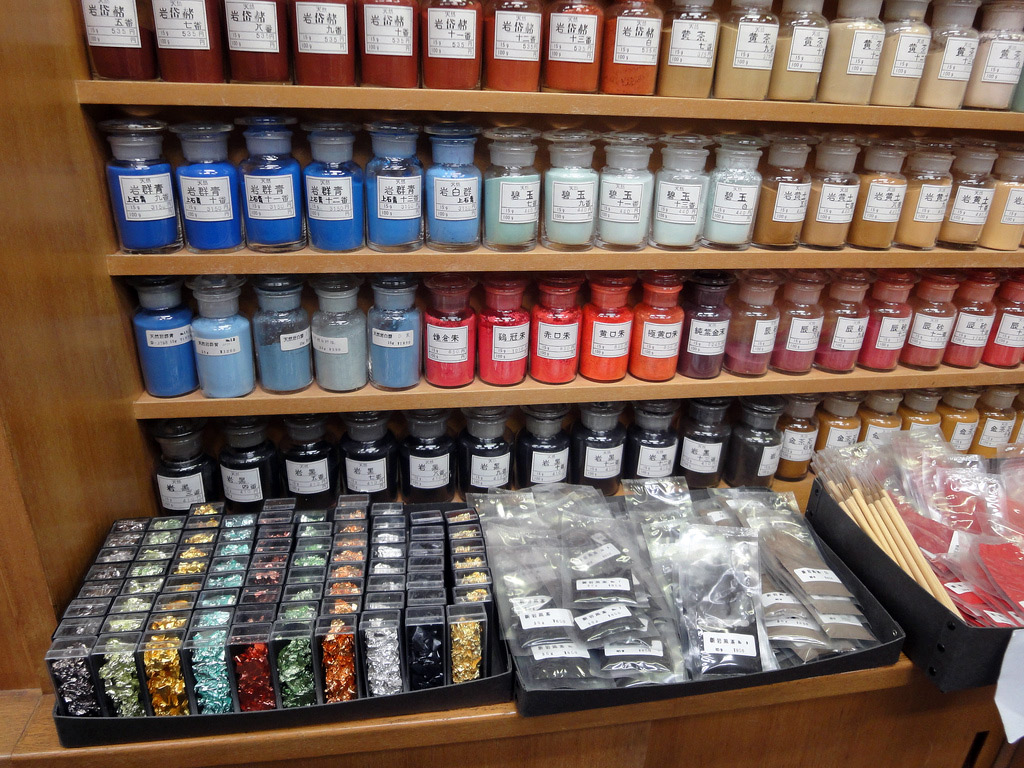 traditional paints and pigments in jars on shelves
