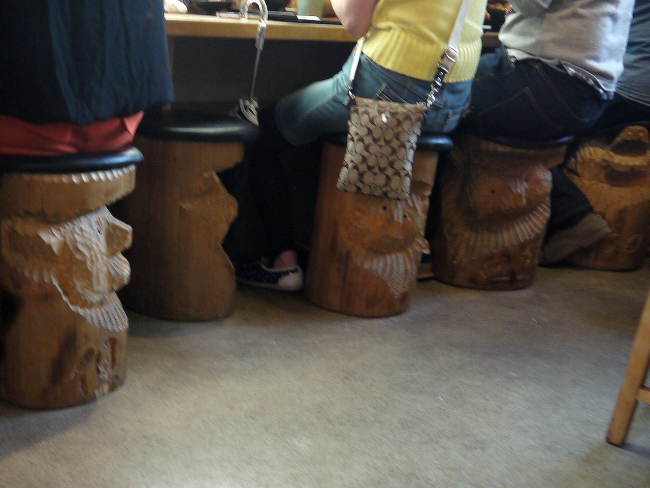 human butts on stools carved to look like bears