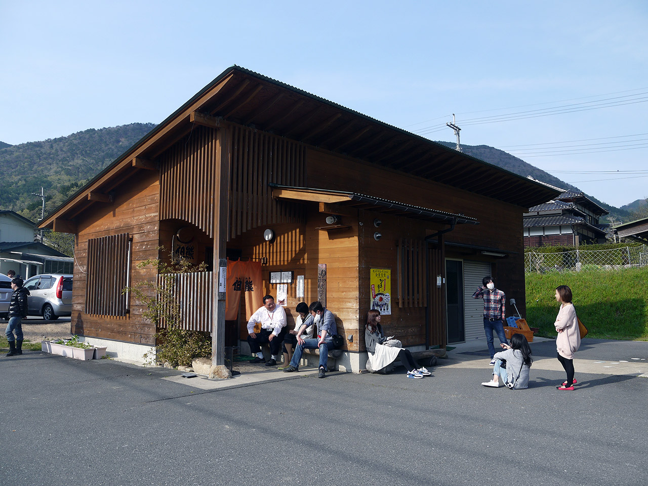 japanese people waiting outside a country restaurant