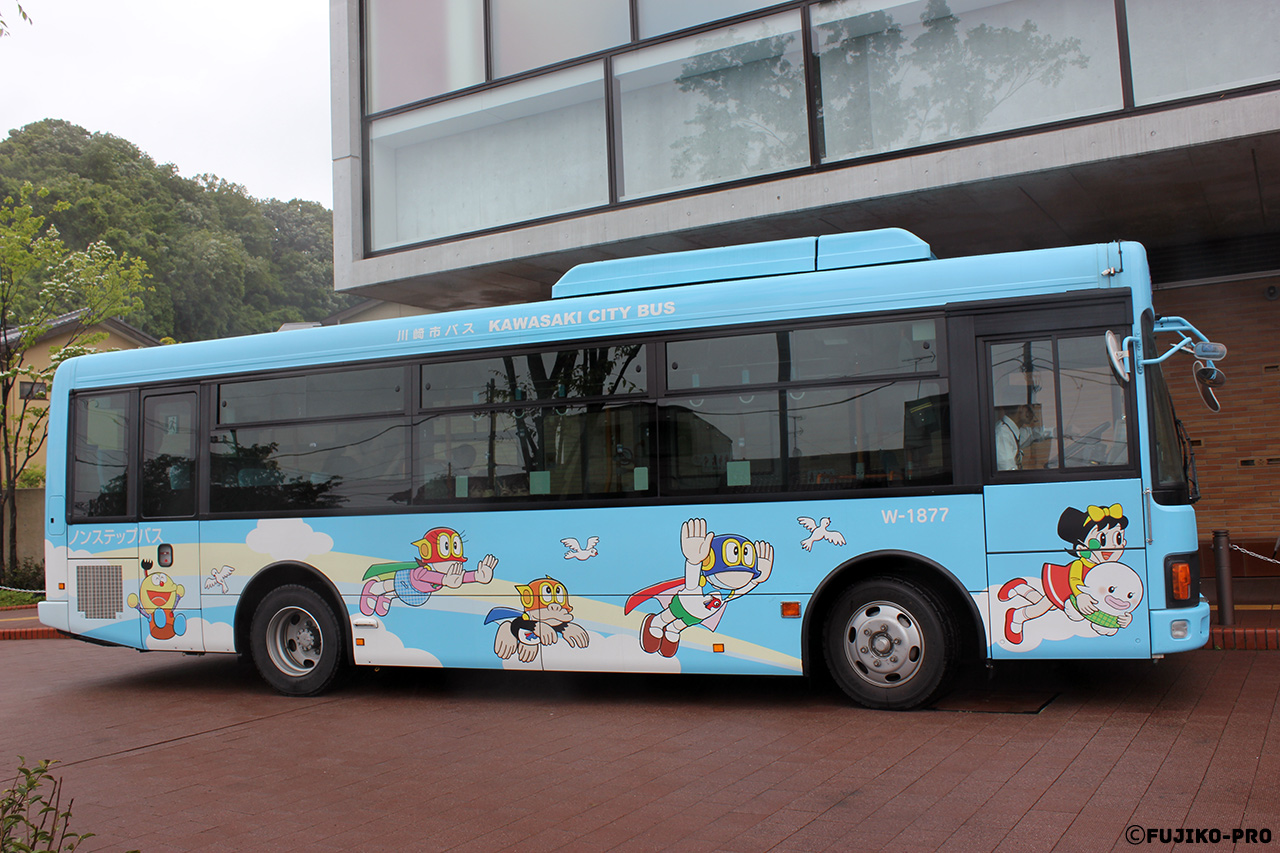 city bus japan with cartoon characters on it