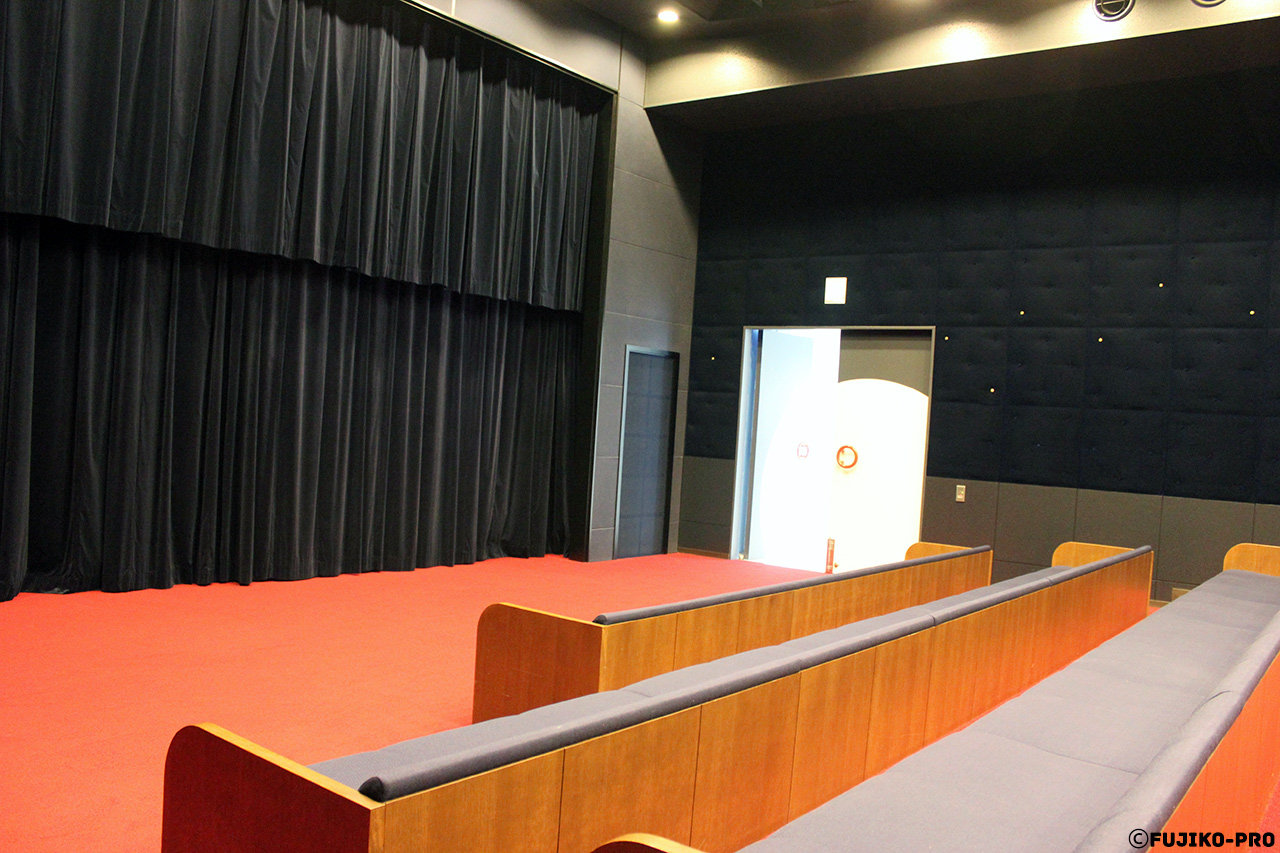 indoor theater black curtains
