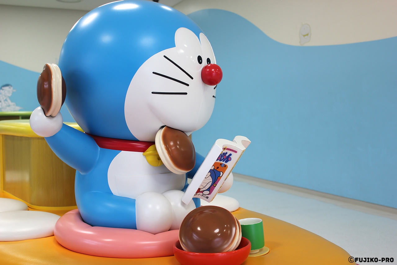 blue space cat doraemon statue