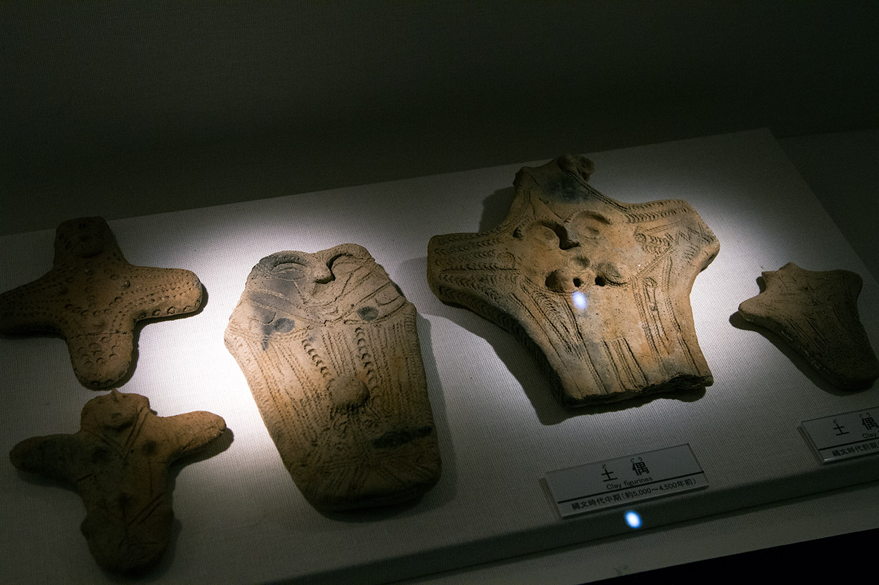 clay figures on display in museum