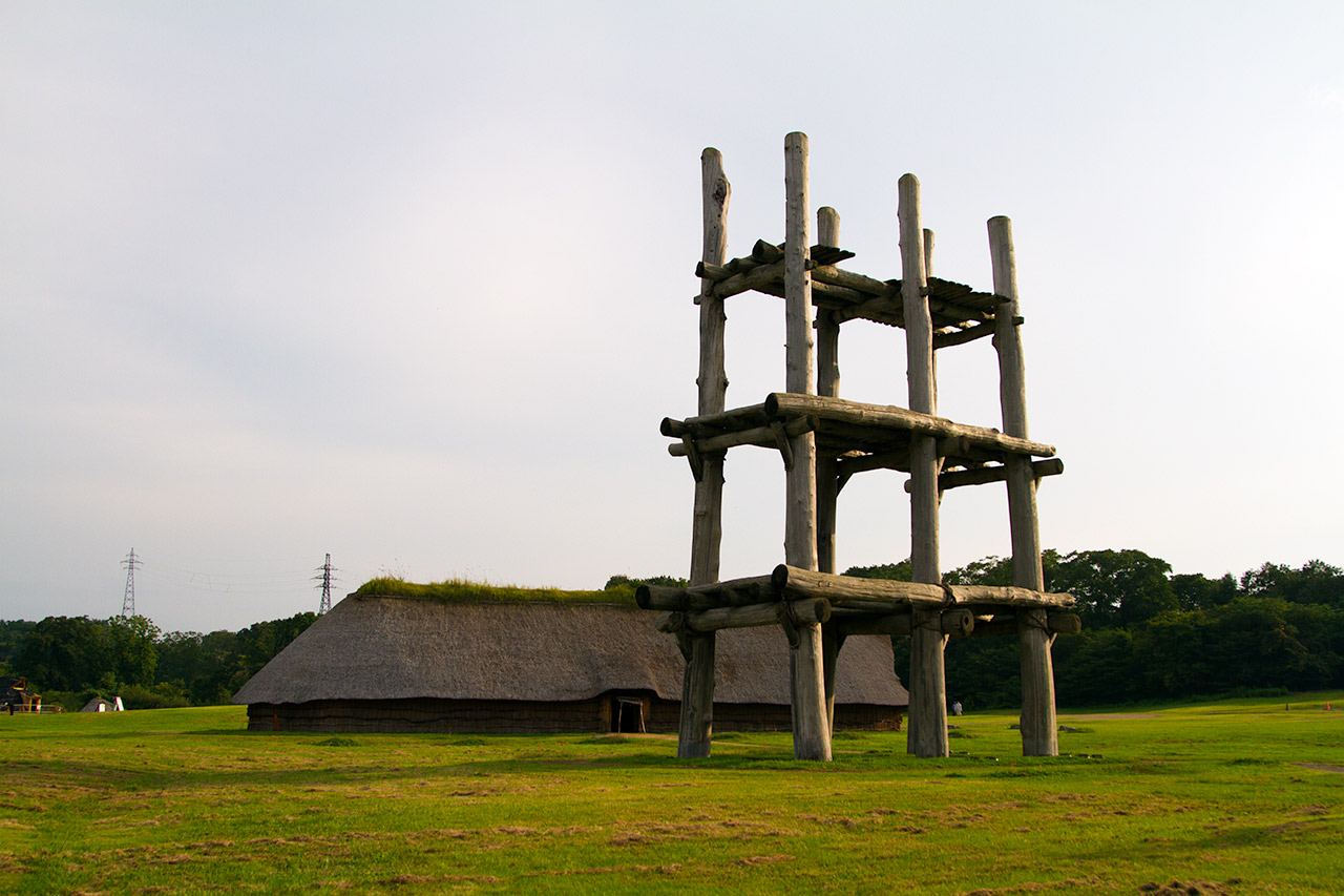large hut next to pillar structure