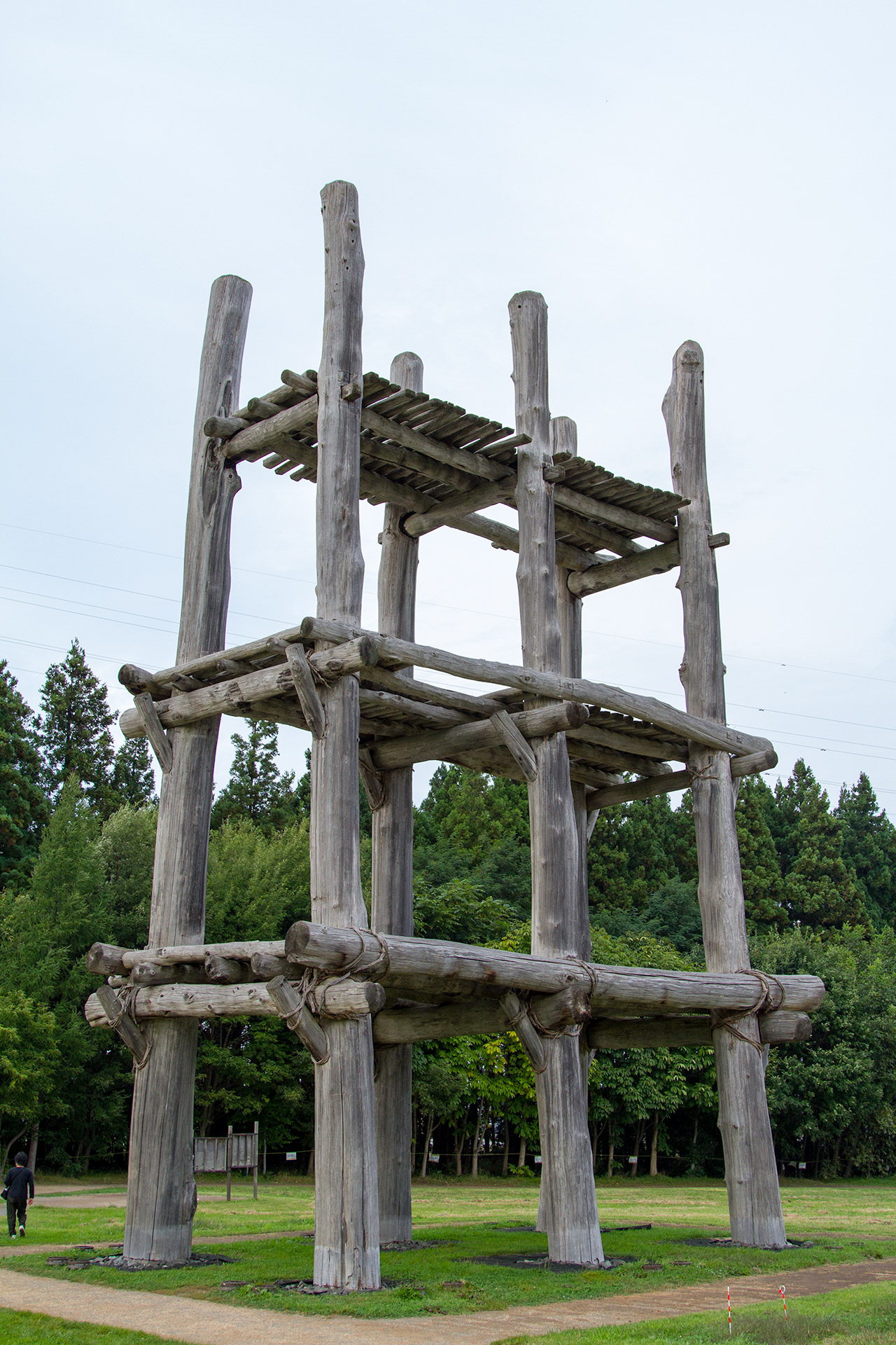 three levelled wooden structure with platforms