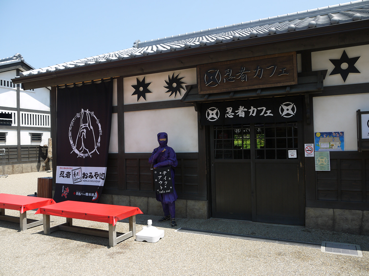 ninja themed restaurant with manikin out front