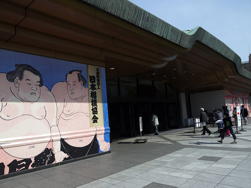 stadium entrance with mural of sumo wrestlers