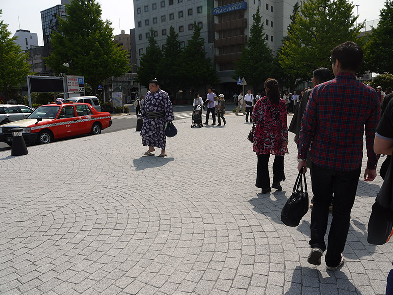 sumo wrestler walking down the street in Japan