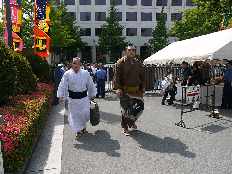 pair of sumo wrestlers heading to stadium