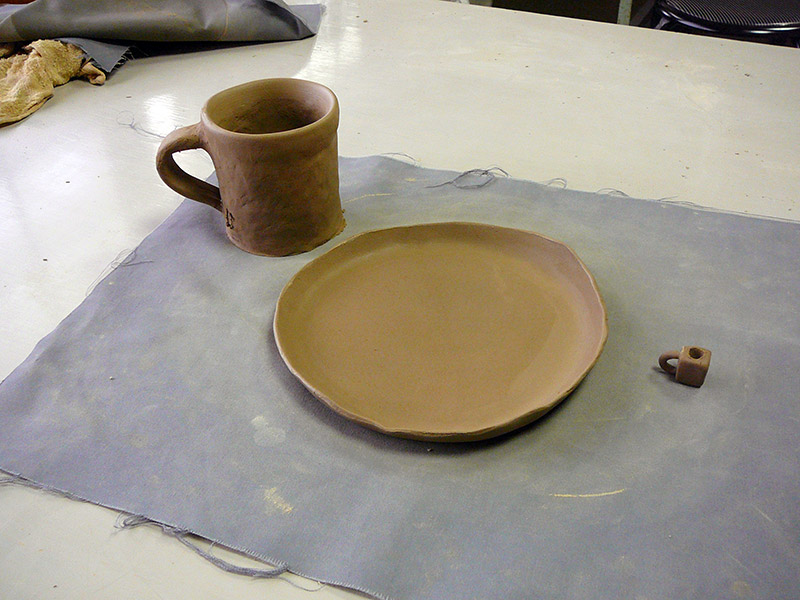 self-made clay mug and plate