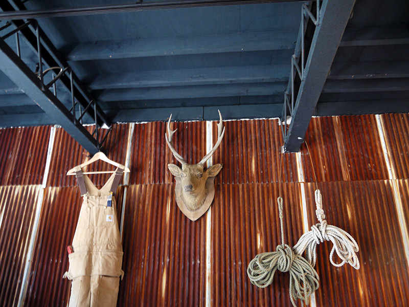 deer overalls and rope hanging on walls rustic japan