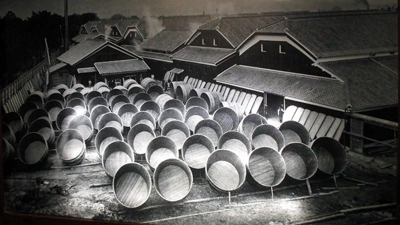 giant sake barrels on the streets of japan