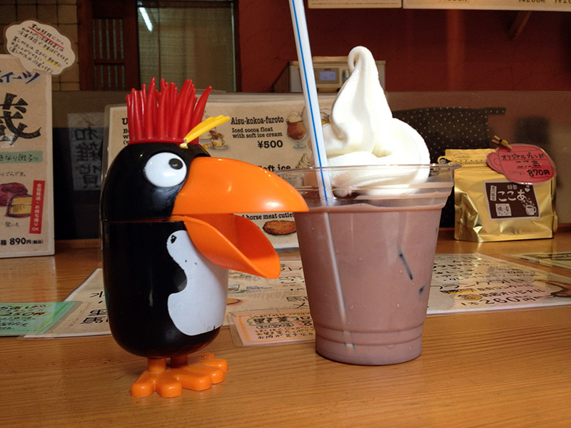 toy penguin and beverage