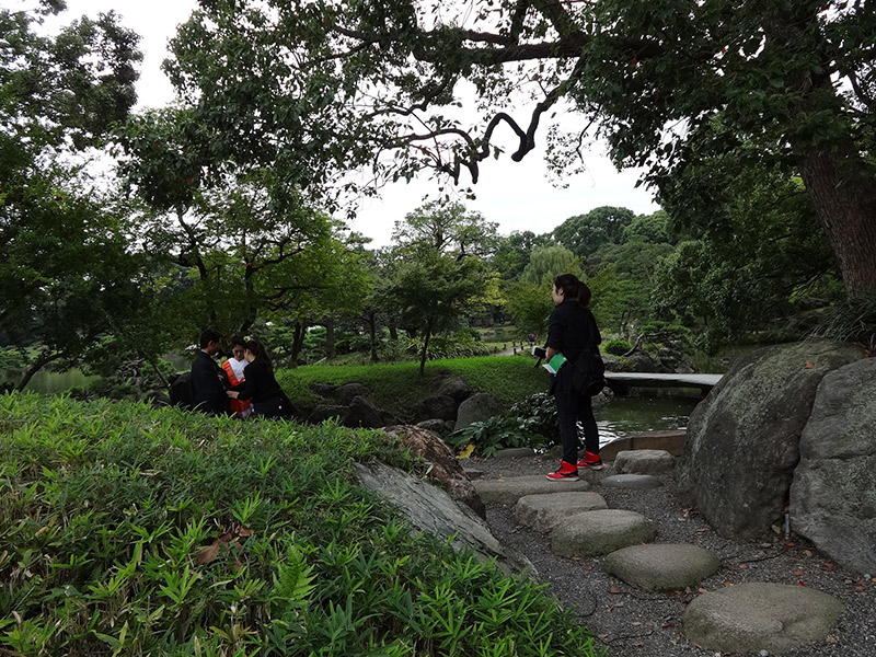 A group of Japanese people relaxing at the Kiyosumi Garden