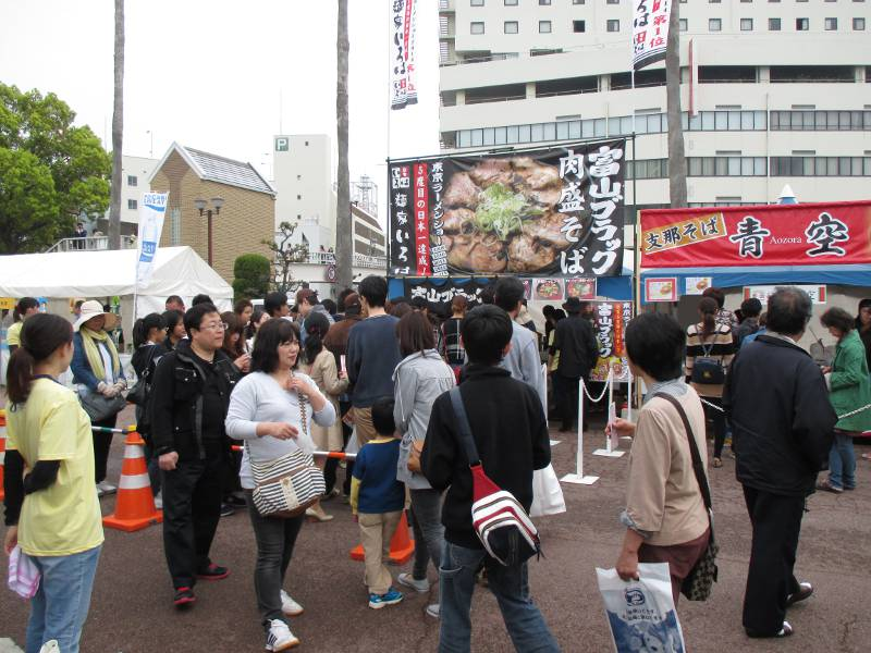japanese people at a busy ramen festival in tokushima