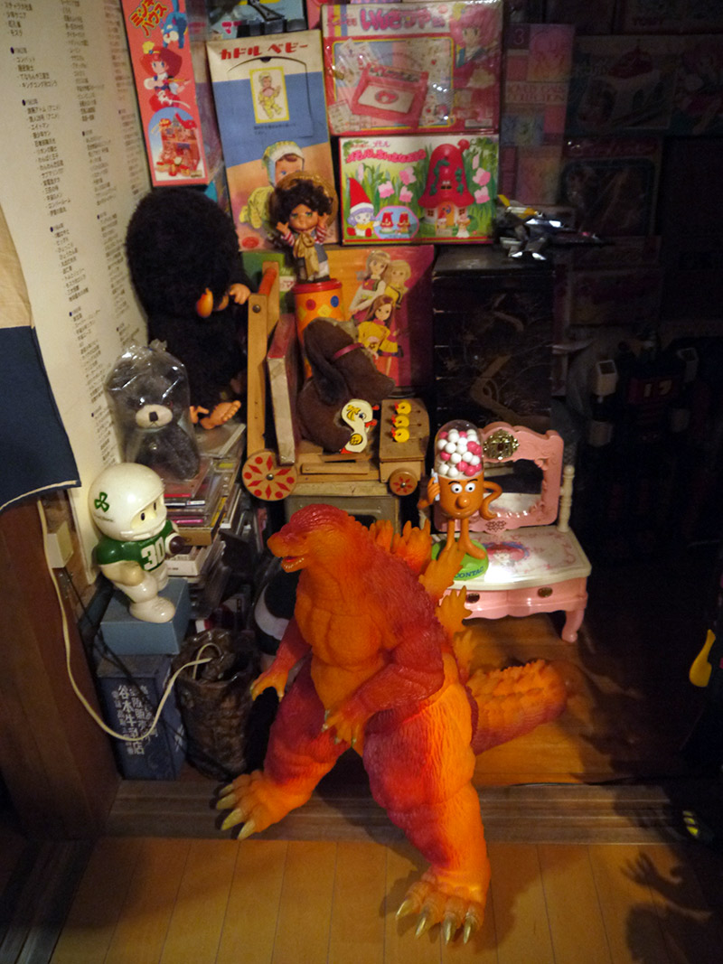 A large model of an orange colored Godzilla