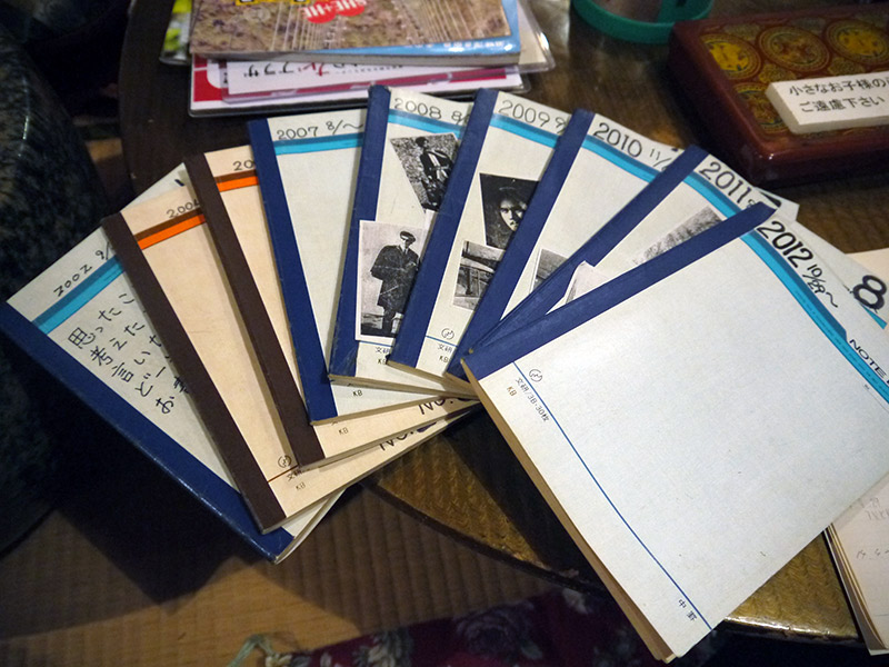 A pile of Japanese notebooks