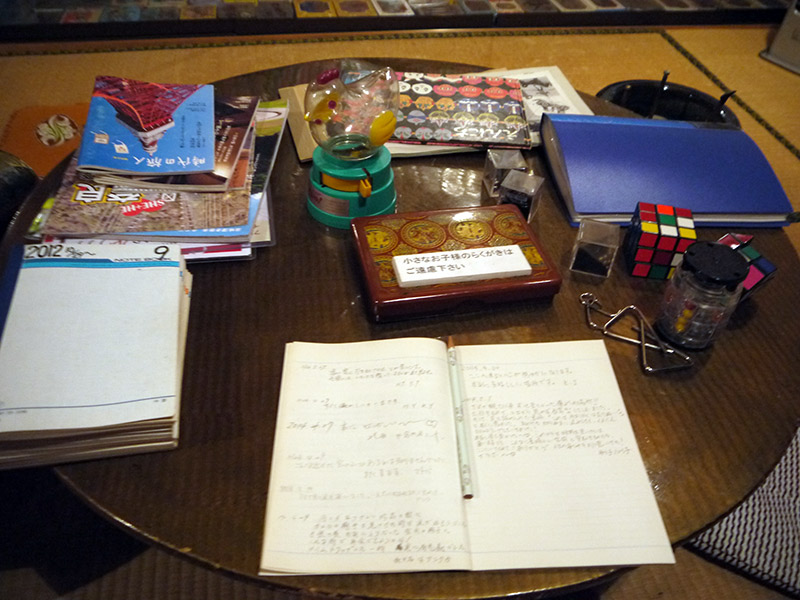 A table of vintage school supplies and Rubik's cubes
