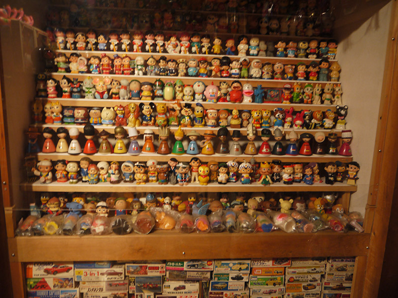 A shelf of small statues and figurines