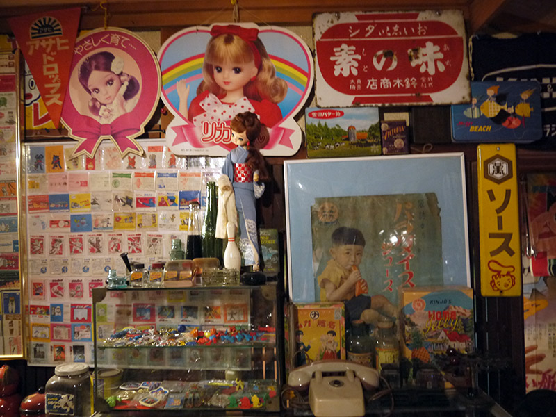 A couple of signs with a doll of Licca-chan