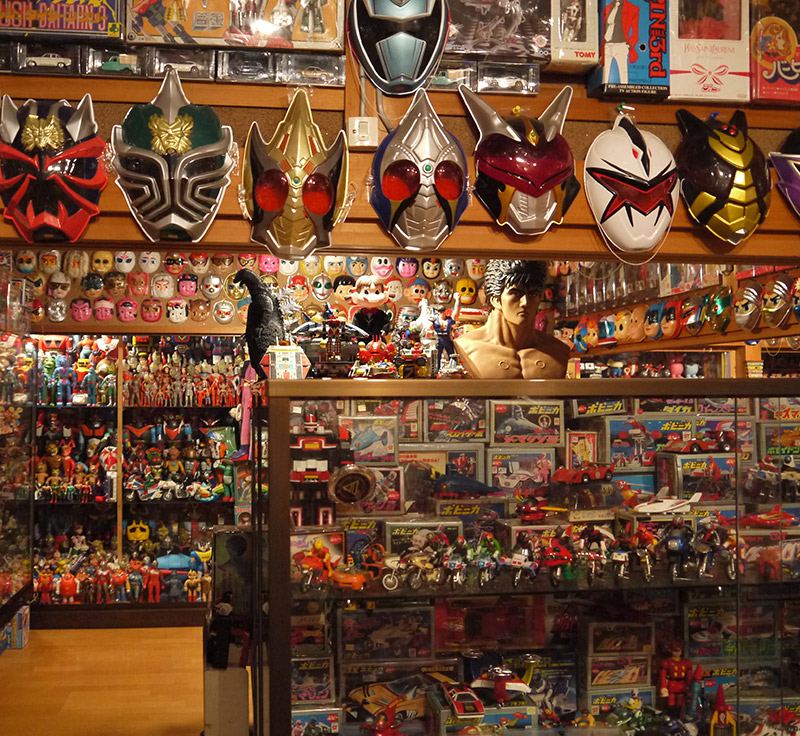 A wall adorned with Ultraman masks