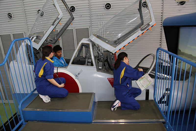 Employees setting up the simulator at the JASDF Air Park