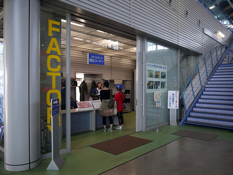 A counter with people renting JASDF costumes