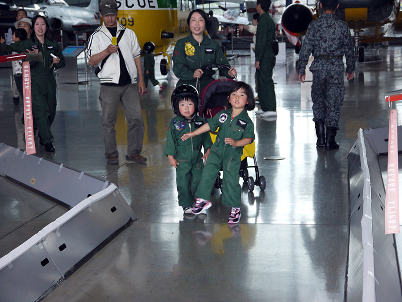 Two kids dressed up as JASDF personnel