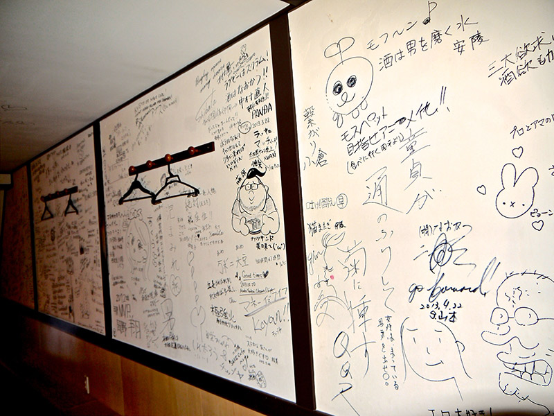 scribbles and doodles from customers on the wall