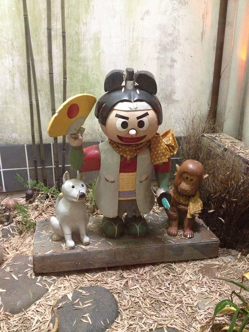 Momotaro statue with dog and monkey friend