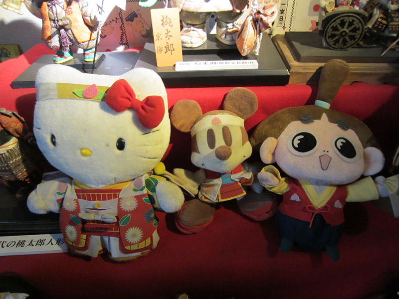 Momotaro, mickey, and hello kitty stuffed dolls