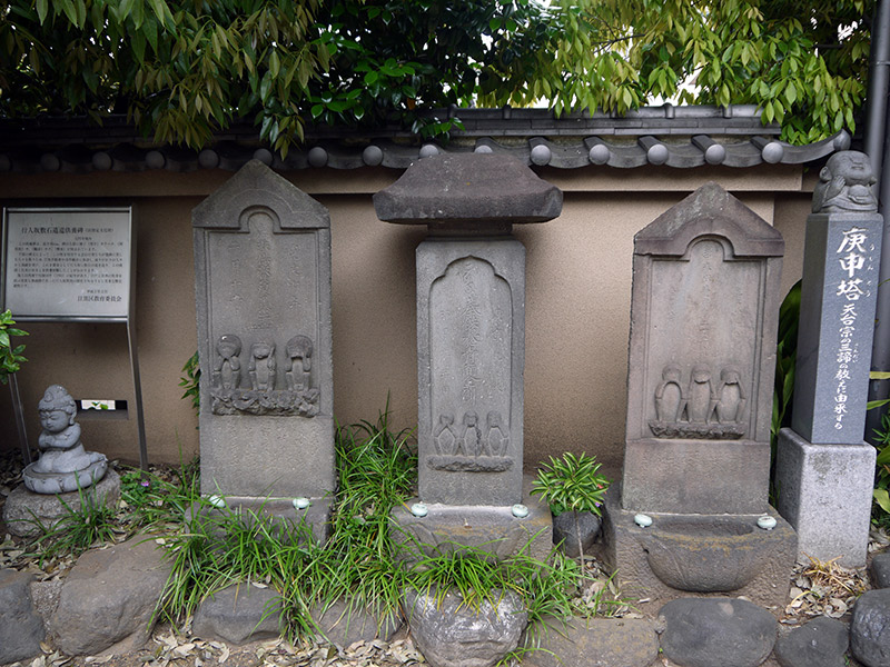 three stone pillars with figures japanese buddhist shrine