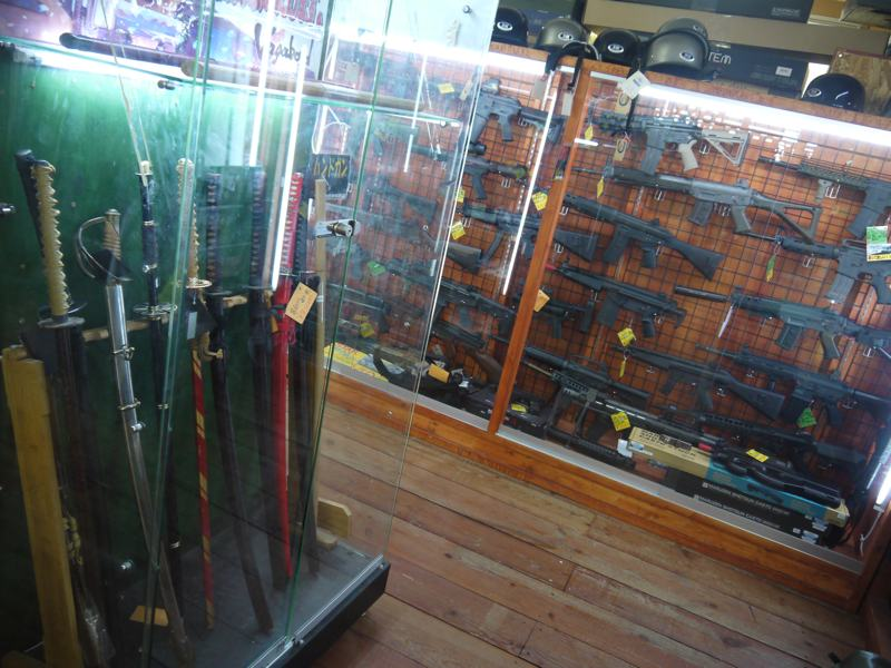 fake swords and fake guns display in cases