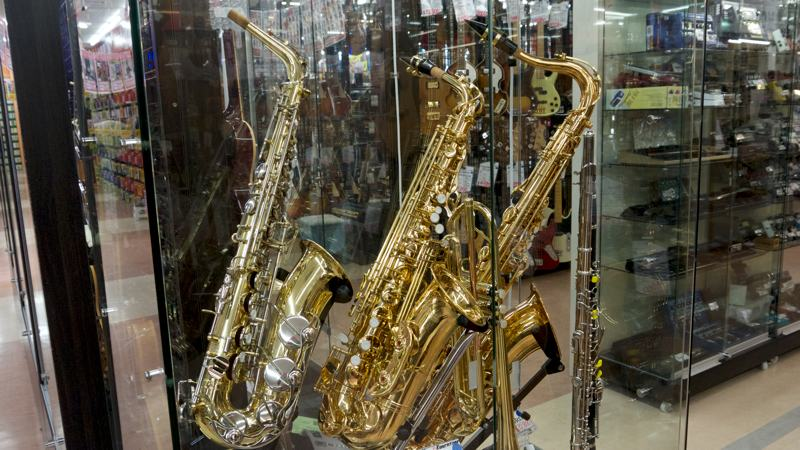 three shiny saxophones for sale