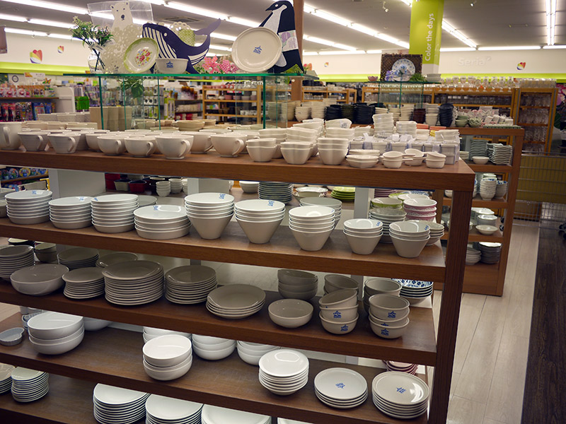 Cream-colored dishes stacked up on shelves
