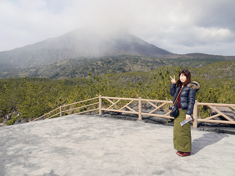Woman posing in front of volcano