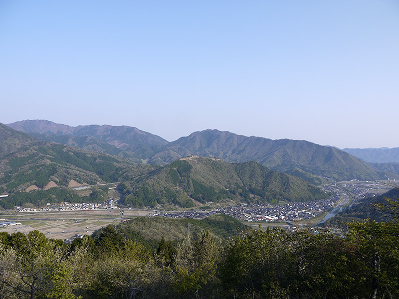 wide view of hills with town bellow in valley