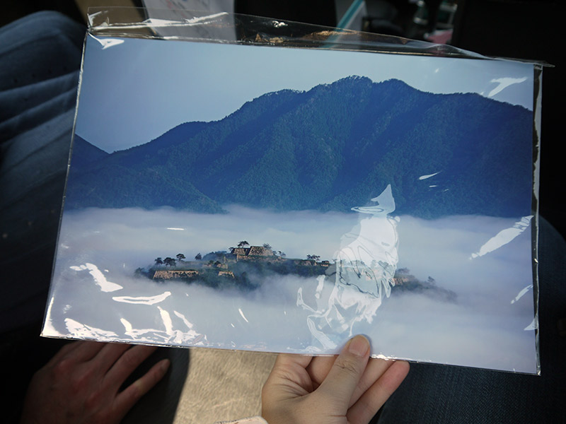 picture of takeda castle surrounded by clouds