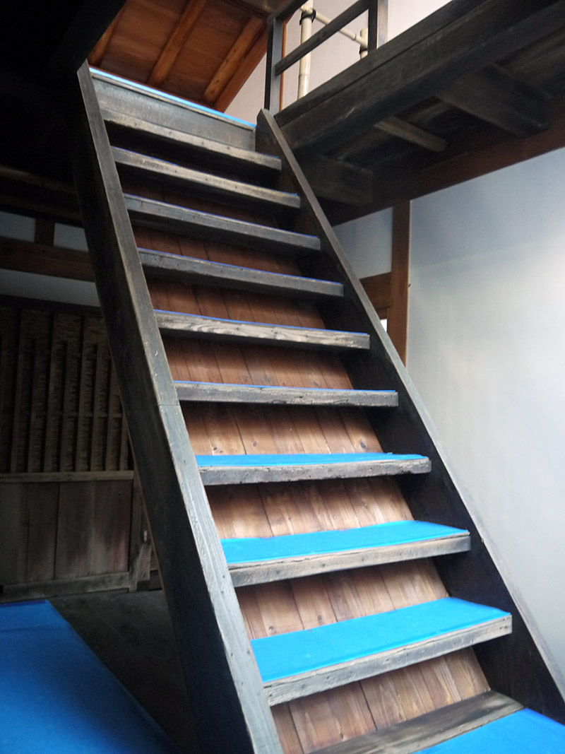 wooden staircase going up to second floor