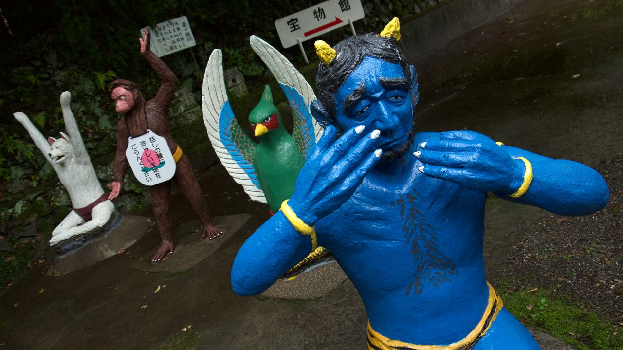 crying blue oni at momotaro park in inuyama