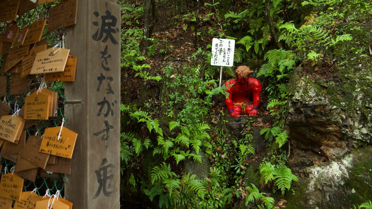 crying red oni at momotaro shrine