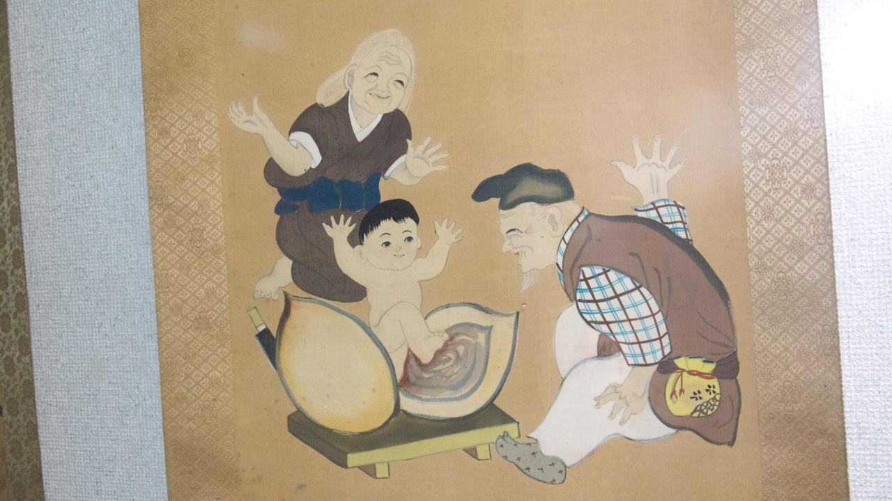 scroll depicting the story of peach boy