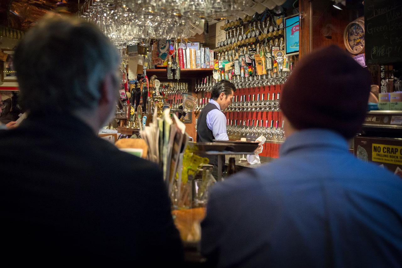 bartender serving japanese craft beer in tokyo
