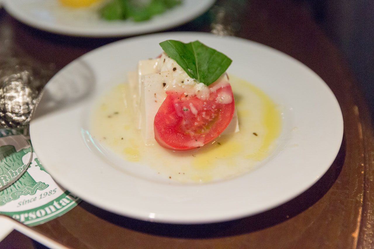caprese salad served with japanese craft beer