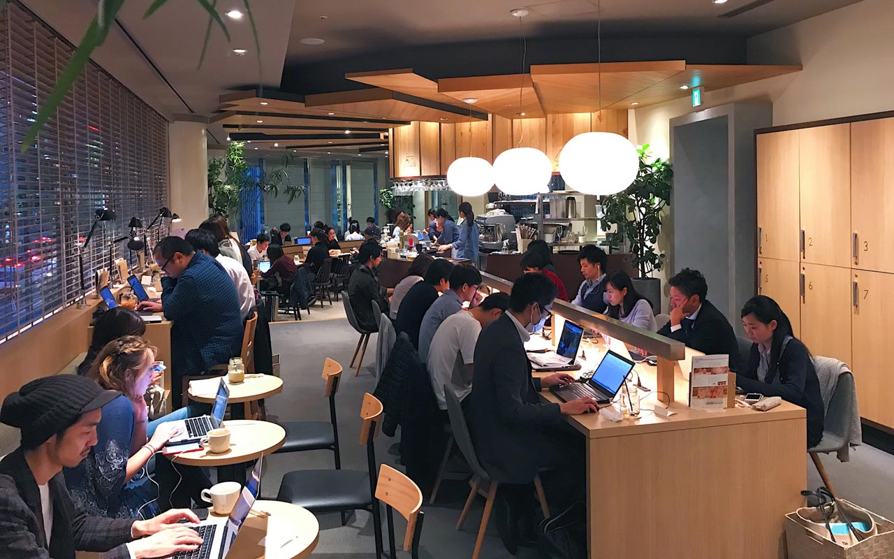 tables and chairs at caffice tokyo coworking space