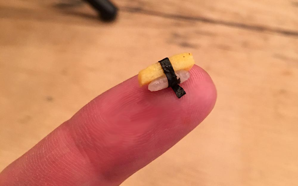 tiny sushi on a finger