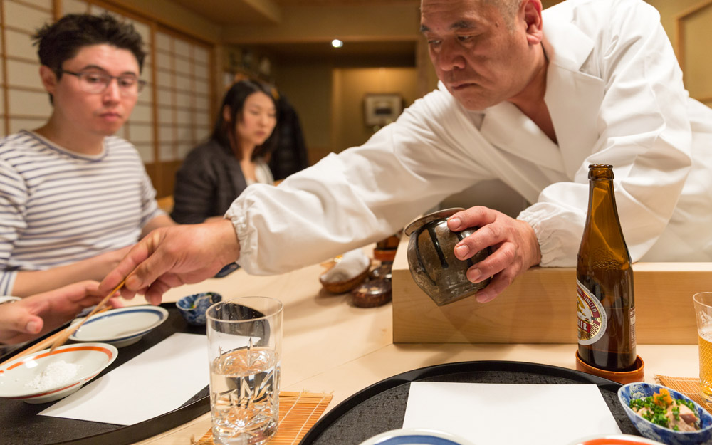 chef sakakibara pouring salt